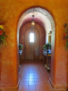 Arched entry leads to front door